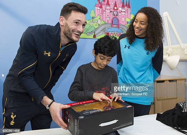 Hugo Lloris and Leah Rawle of Tottenham Hotspur hand out presents to patients at Whipps Cross Hospital on December 21 2016 in London England