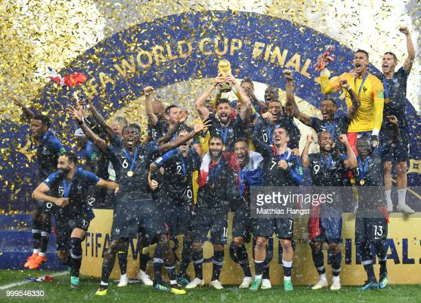Hugo Lloris and Olivier Giroud of France lift the World Cup trophy to celebrate with teammates after the 2018 FIFA World Cup Final between France and...