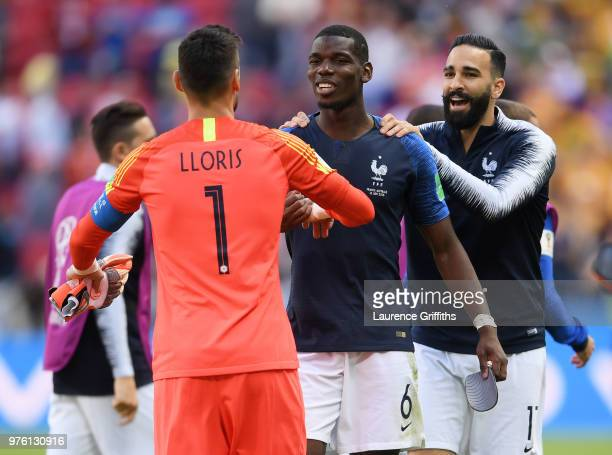 Hugo Lloris celebrates with team mates Paul Pogba and Adil Rami of France following the 2018 FIFA World Cup Russia group C match between France and...