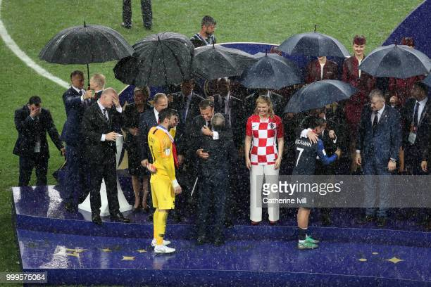 Hugo Lloris Didier Deschamps and Antoine Griezmann of France receive their World Cup Winner's medals following the 2018 FIFA World Cup Final between...