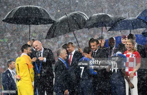 Hugo Lloris Didier Deschamps Antoine Griezmann and Blaise Matuidi of France receive their World Cup Winner's medals following the 2018 FIFA World Cup...