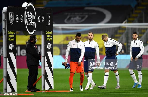 Hugo Lloris Harry Kane Eric Dier and Matt Doherty of Tottenham Hotspur line up prior to the Premier League match between Burnley and Tottenham...
