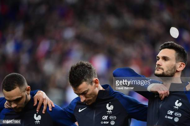 Hugo Lloris Laurent Koscielny and Layvin Kurzawa of France during the friendly match between France and Spain at Stade de France on March 28 2017 in...