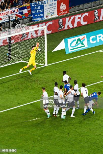 Hugo Lloris of France and Mario Balotelli of Italy shoot the free kick during the International Friendly match between France and Italy at Allianz...