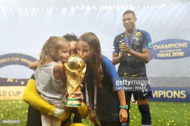 Hugo Lloris of France celebrates victory with daughters Anna Rose and Giuliana following the 2018 FIFA World Cup Final between France and Croatia at...