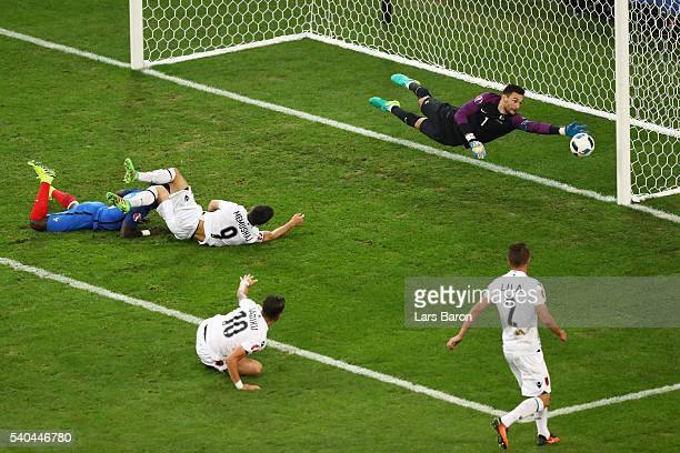 Hugo Lloris of France dives as the ball hits the post during the UEFA EURO 2016 Group A match between France and Albania at Stade Velodrome on June...