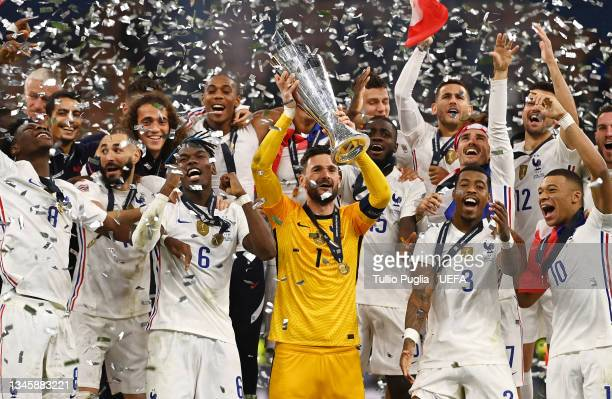 Hugo Lloris of France lifts the UEFA Nations League trophy following victory in the UEFA Nations League 2021 Final match between Spain and France at...