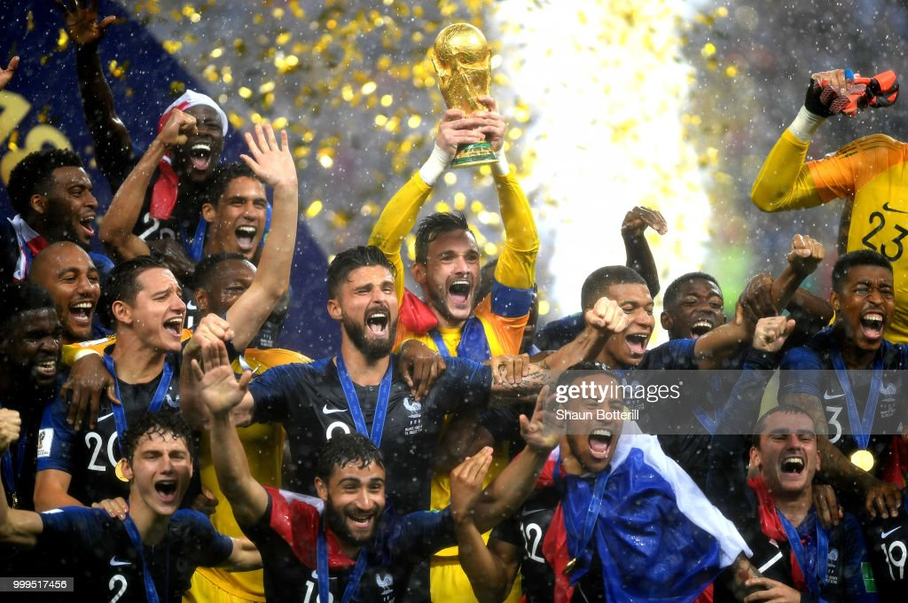 Hugo Lloris of France lifts the World Cup trophy to celebrate with his teammates after the 2018 FIFA World Cup Final between France and Croatia at Luzhniki Stadium on July 15, 2018 in Moscow, Russia.