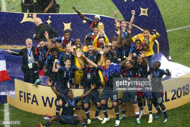 Hugo Lloris of France lifts the World Cup trophy to celebrate with his teammates after the 2018 FIFA World Cup Final between France and Croatia at...