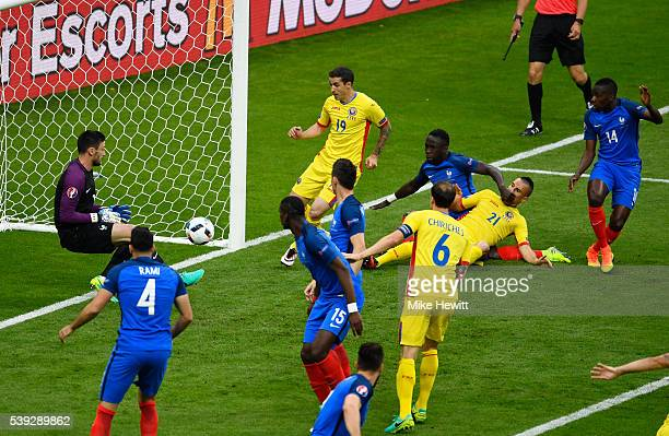Hugo Lloris of France makes a save during the UEFA Euro 2016 Group A match between France and Romania at Stade de France on June 10 2016 in Paris...