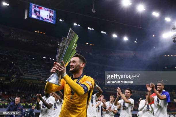 Hugo Lloris of France parades the trophy with teammates following the 2-1 victory in the UEFA Nations League 2021 Final match between Spain and...
