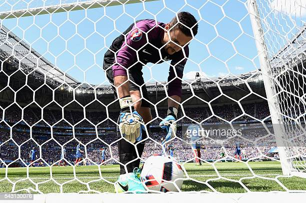 Hugo Lloris of France picks up the ball from the back of the net after Ireland's first goal during the UEFA EURO 2016 round of 16 match between...