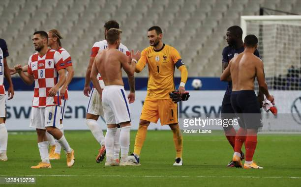 Hugo LLoris of France reacts with Croatian players after the UEFA Nations League group stage match between France and Croatia at Stade de France on...