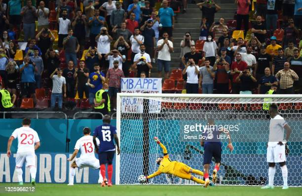 Hugo Lloris of France saves a penalty taken by Ricardo Rodriguez of Switzerland during the UEFA Euro 2020 Championship Round of 16 match between...