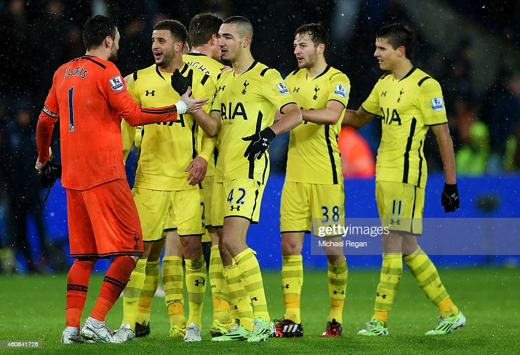 Hugo Lloris of Spurs celebrates with team-mates Kyle Walker and Nabil Bentaleb of Spurs after the Barclays Premier League match between Leicester City and Tottenham Hotspur at The King Power Stadium on December 26, 2014 in Leicester, England.