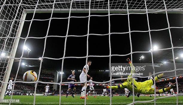 Hugo Lloris of Spurs dives in vain as Guillaume Gillet of Anderlecht scores a goal to level the scores at 11 during the UEFA Europa League Group J...