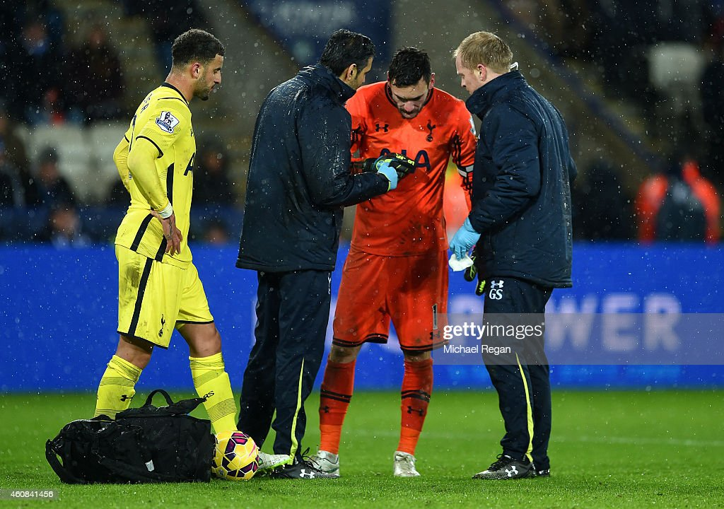 Hugo Lloris of Spurs receives treatment for an injury during the Barclays Premier League match between Leicester City and Tottenham Hotspur at The King Power Stadium on December 26, 2014 in Leicester, England.