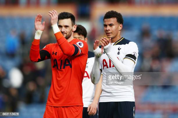 Hugo Lloris of Tottenham Hotspur and Dele Alli of Tottenham Hotspur shows appreciation to the fans after the Premier League match between Burnley and...