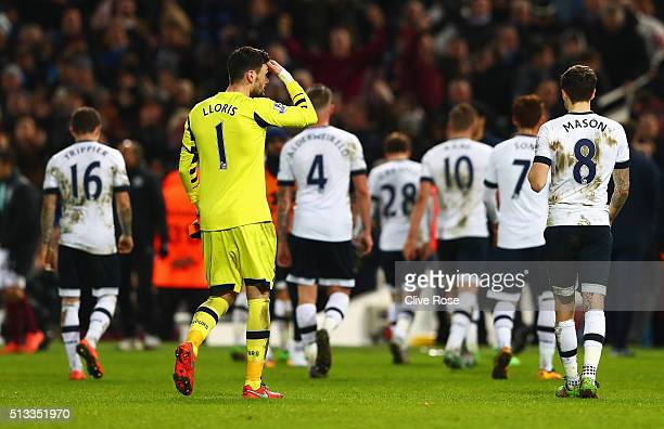 Hugo Lloris of Tottenham Hotspur and the rest of Tottenham players walk off dejected after the Barclays Premier League match between West Ham United...