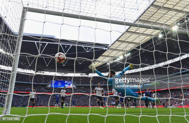 Hugo Lloris of Tottenham Hotspur attempts to save as Willian of Chelsea scores his sides first goal during The Emirates FA Cup SemiFinal between...