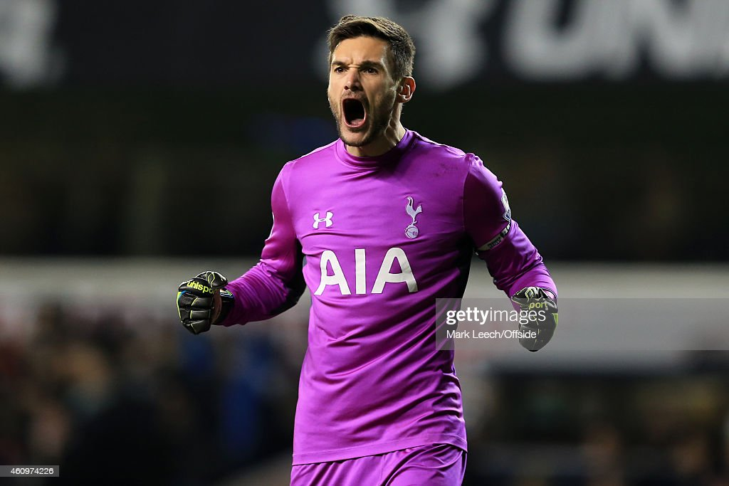 Hugo Lloris of Tottenham Hotspur celebrates a goal from Harry Kane during the Barclays Premier League match between Tottenham Hotspur and Chelsea at White Hart Lane on January 1, 2015 in London, England.