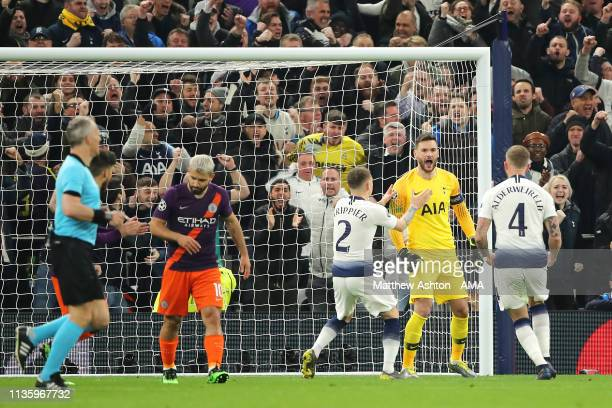 Hugo Lloris of Tottenham Hotspur celebrates saving the penalty of Sergio Aguero of Manchester City during the UEFA Champions League Quarter Final...