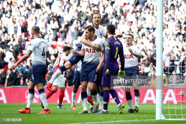 Hugo Lloris of Tottenham Hotspur celebrates with teammates after saving a penalty during the Premier League match between Tottenham Hotspur and...