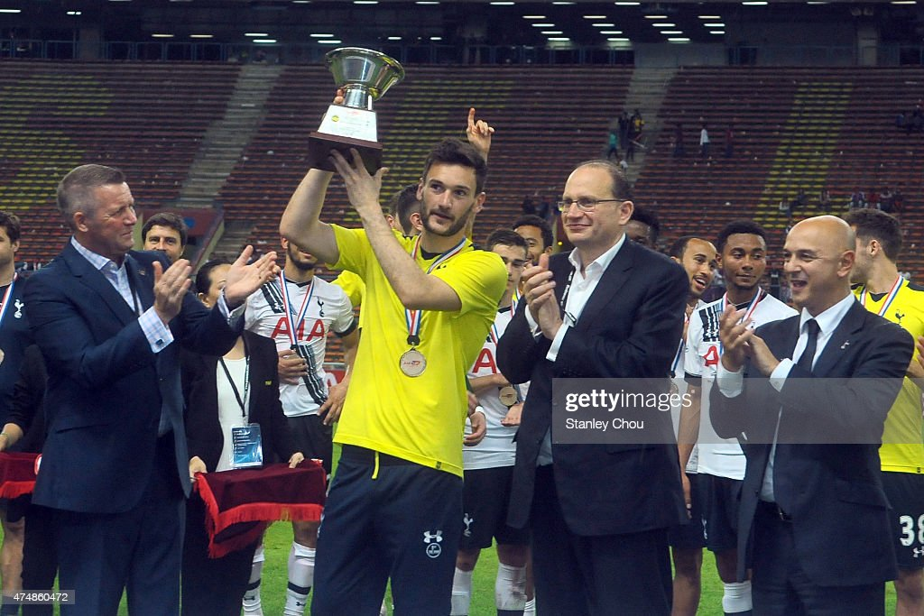 Hugo LLoris of Tottenham Hotspur celebrates with the AIA Cup after they defeated Malaysia XI 2-1 during the pre-season friendly match between Malaysia XI and Tottenham Hotspur at Shah Alam Stadium on May 27, 2015 in Shah Alam, Malaysia.