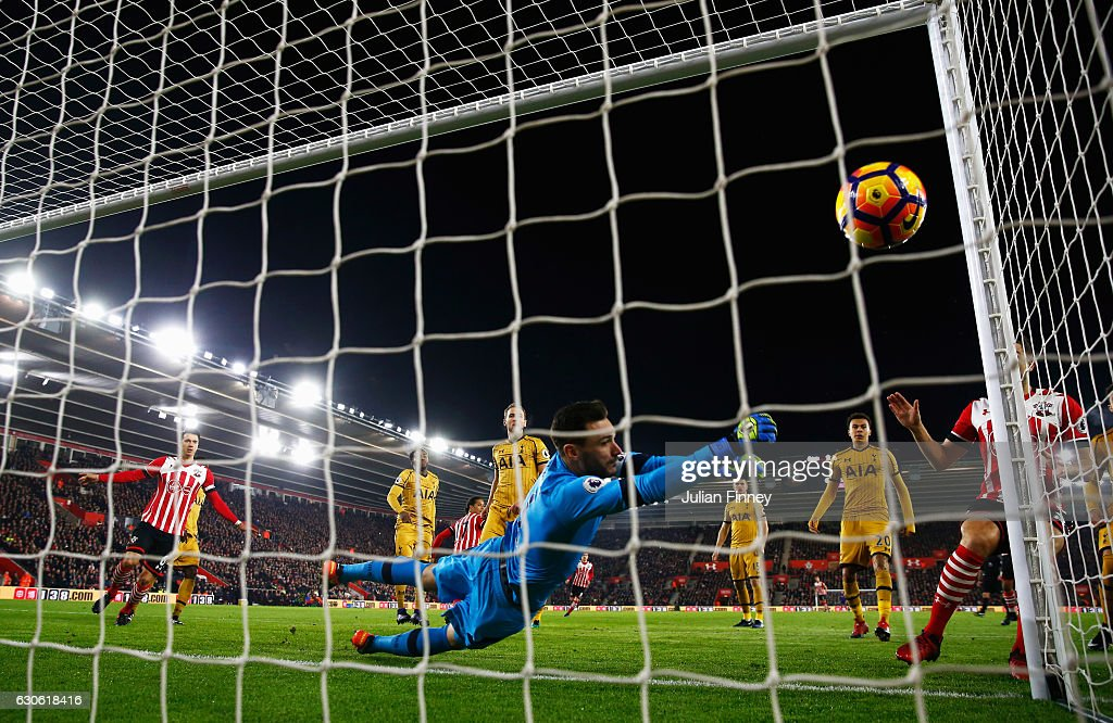 Hugo Lloris of Tottenham Hotspur dives in vain as as Virgil van Dijk of Southampton (C) scores their first goal during the Premier League match between Southampton and Tottenham Hotspur at St Mary's Stadium on December 28, 2016 in Southampton, England.