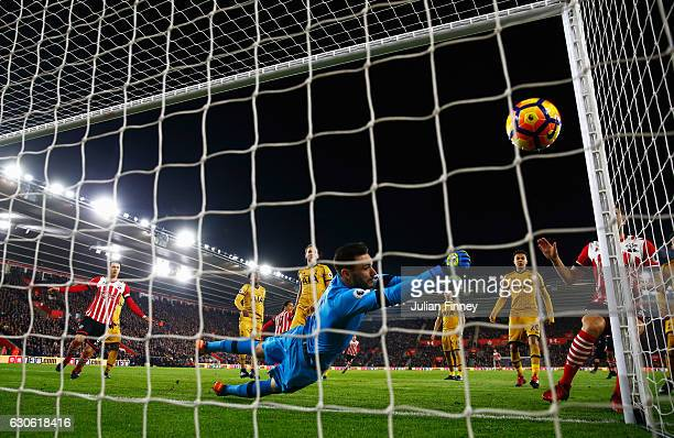 Hugo Lloris of Tottenham Hotspur dives in vain as as Virgil van Dijk of Southampton scores their first goal during the Premier League match between...