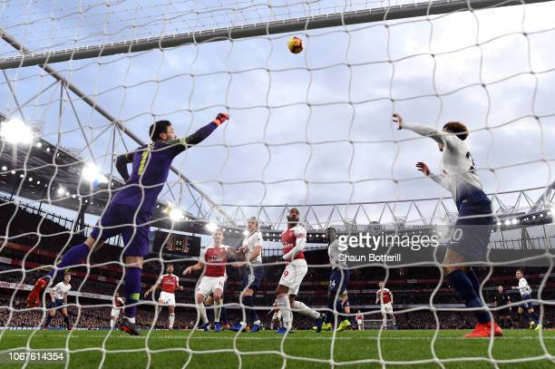Hugo Lloris of Tottenham Hotspur dives to make a save as Dele Alli of Tottenham Hotspur stands on the line during the Premier League match between...