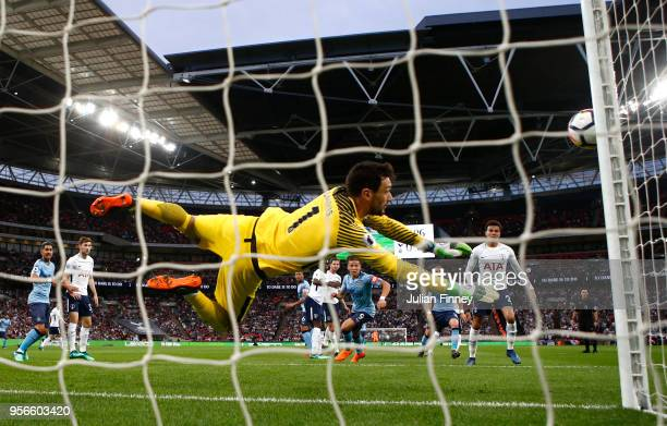 Hugo Lloris of Tottenham Hotspur dives to make a save during the Premier League match between Tottenham Hotspur and Newcastle United at Wembley...