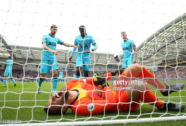 Hugo Lloris of Tottenham Hotspur goes down injured during the Premier League match between Brighton & Hove Albion and Tottenham Hotspur at American...