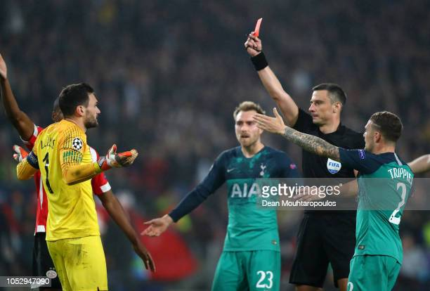 Hugo Lloris of Tottenham Hotspur is shown a red card by referee Slavko Vincic during the Group B match of the UEFA Champions League between PSV and...