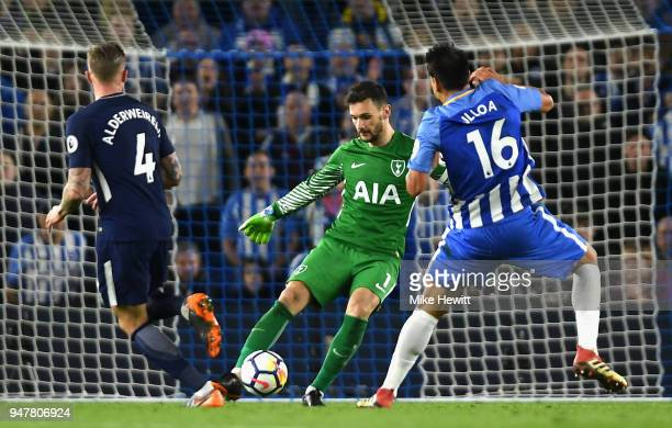 Hugo Lloris of Tottenham Hotspur kicks the ball past Toby Alderweireld of Tottenham Hotspur and Leonardo Ulloa of Brighton and Hove Albion during the...