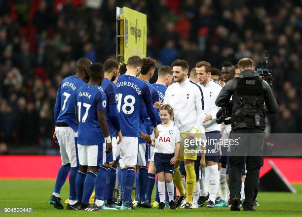 Hugo Lloris of Tottenham Hotspur leads his team as they shake hands with the Everton team prior to the Premier League match between Tottenham Hotspur...