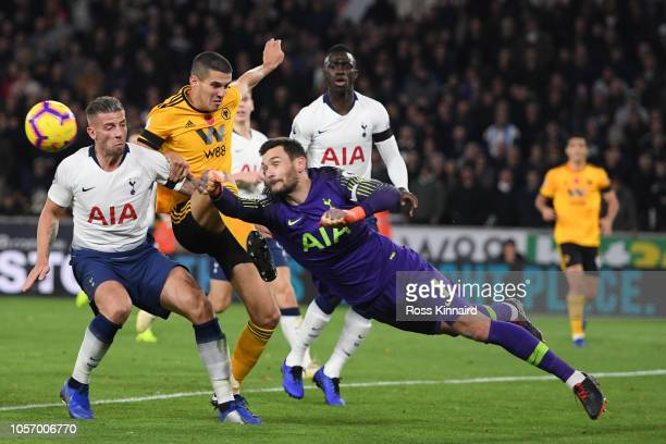 Hugo Lloris of Tottenham Hotspur makes a save from Conor Coady of Wolverhampton Wanderers during the Premier League match between Wolverhampton...