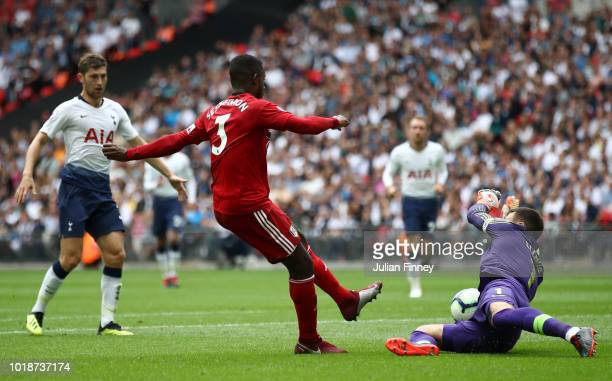 Hugo Lloris of Tottenham Hotspur makes a save from Ryan Sessegnon of Fulham during the Premier League match between Tottenham Hotspur and Fulham FC...