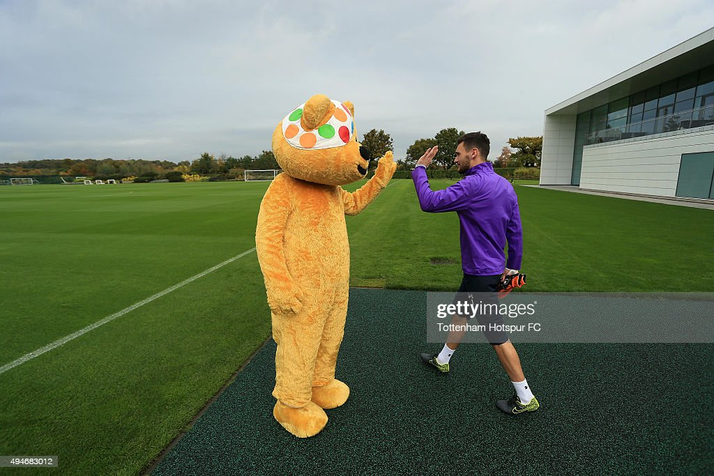 Hugo Lloris of Tottenham Hotspur meets Children In Need's Pudsey Bear at the club's training ground on October 28, 2015 in Enfield, England.