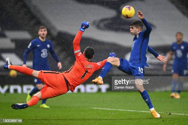 Hugo Lloris of Tottenham Hotspur punches the ball clear from Christian Pulisic of Chelsea during the Premier League match between Tottenham Hotspur...