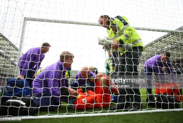 Hugo Lloris of Tottenham Hotspur receives medical treatment during the Premier League match between Brighton Hove Albion and Tottenham Hotspur at...