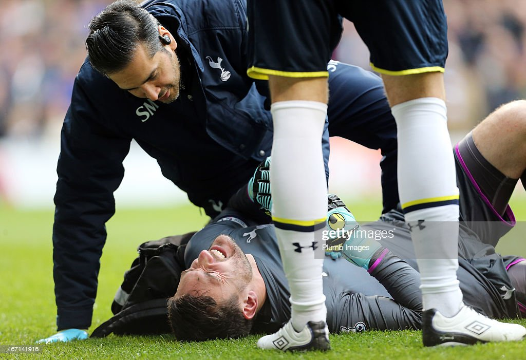 Hugo Lloris of Tottenham Hotspur receives treatment before being substituted early on during the Premier League match between Tottenham Hotspur and Leicester City at White Hart Lane on March 21, 2015 in London, England.