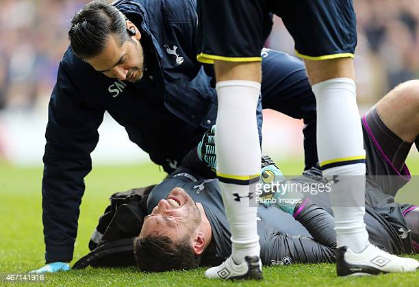 Hugo Lloris of Tottenham Hotspur receives treatment before being substituted early on during the Premier League match between Tottenham Hotspur and...