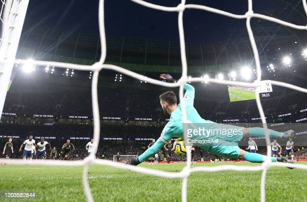 Hugo Lloris of Tottenham Hotspur saves a penalty from Ilkay Gundogan of Manchester City during the Premier League match between Tottenham Hotspur and...