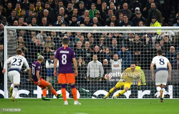 Hugo Lloris of Tottenham Hotspur saves a penalty from Sergio Aguero of Manchester City during the UEFA Champions League Quarter Final first leg match...
