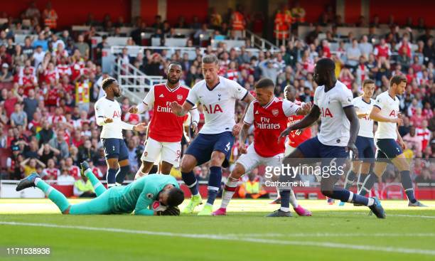 Hugo Lloris of Tottenham Hotspur saves a shot during the Premier League match between Arsenal FC and Tottenham Hotspur at Emirates Stadium on...