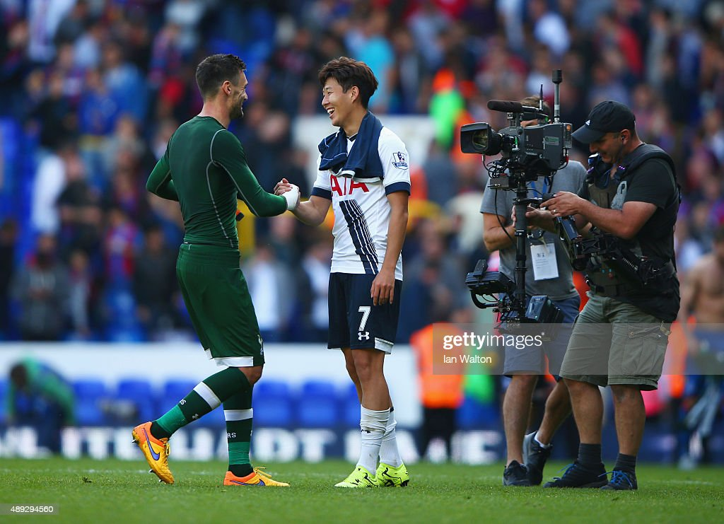 Hugo Lloris of Tottenham Hotspur shakes hands with Son Heung-Min of Tottenham Hotspur after victory in the Barclays Premier League match between Tottenham Hotspur and Crystal Palace at White Hart Lane on September 20, 2015 in London, United Kingdom.