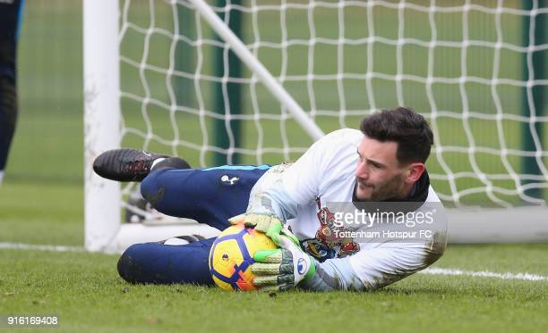 Hugo Lloris of Tottenham Hotspur trains in a Chinese New Year tshirt ahead of the north london derby during the Tottenham Hotspur training session at...