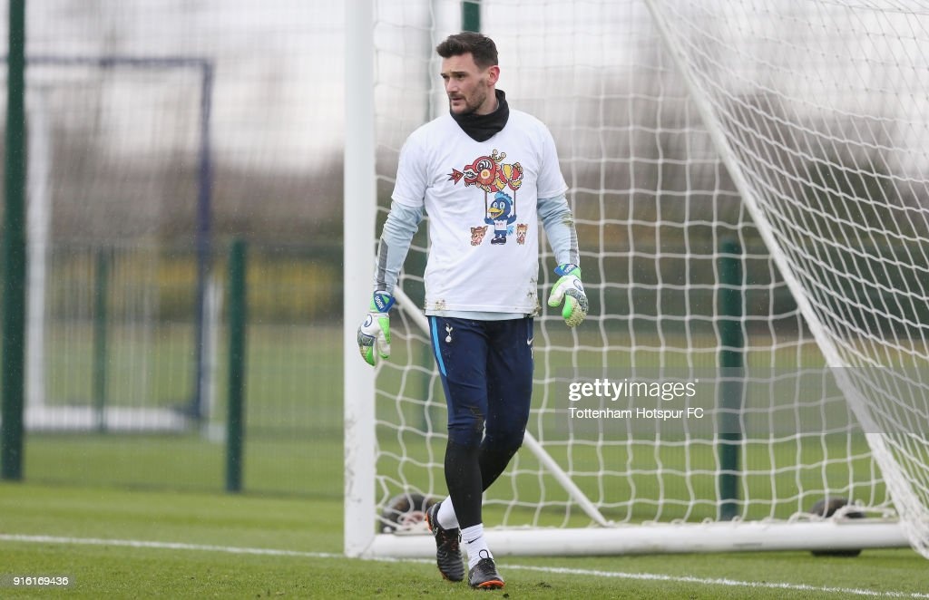 Hugo Lloris of Tottenham Hotspur trains in a Chinese New Year t-shirt ahead of the north london derby during the Tottenham Hotspur training session at Tottenham Hotspur Training Centre on February 9, 2018 in Enfield, England.