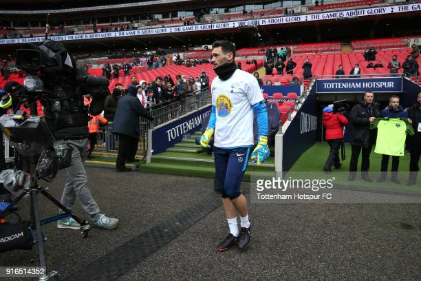 Hugo Lloris of Tottenham Hotspur walks out to warm up prior to the Premier League match between Tottenham Hotspur and Arsenal at Wembley Stadium on...